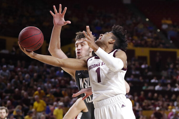 Arizona State guard Remy Martin shoots under Washington State center Volodymyr Markovetskyy, left, during the second half of an NCAA college basketball game Saturday, March 7, 2020, in Tempe, Ariz. (AP Photo/Matt York)