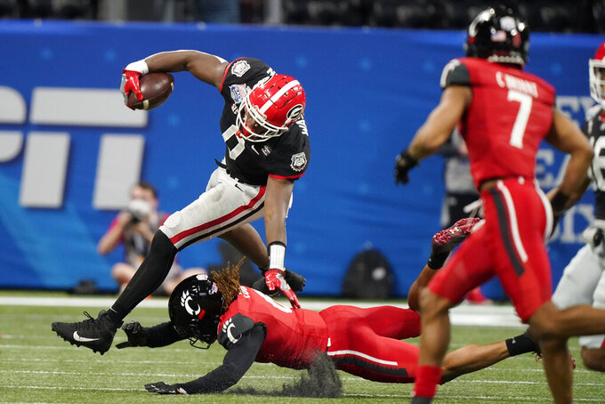 Georgia tight end Darnell Washington (0) runs against Cincinnati during the first half of the Peach Bowl NCAA college football game, Friday, Jan. 1, 2021, in Atlanta. (AP Photo/Brynn Anderson)