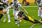 Philadelphia Eagles quarterback Carson Wentz (11) is sacked by Pittsburgh Steelers outside linebacker T.J. Watt (90) during the first half of an NFL football game in Pittsburgh, Sunday, Oct. 11, 2020. (AP Photo/Don Wright)