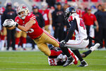 San Francisco 49ers tight end George Kittle, left, runs against Atlanta Falcons defensive back Blidi Wreh-Wilson (33) and linebacker Deion Jones (45) during the first half of an NFL football game in Santa Clara, Calif., Sunday, Dec. 15, 2019. (AP Photo/John Hefti)