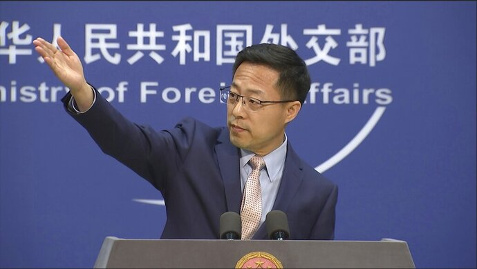 Chinese foreign ministry spokesperson Zhao Lijian gestures during a press briefing in Beijing on Monday, Nov. 23, 2020. China on Monday lashed out at Washington over its withdrawal from the