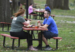 Hannah Wilson and James Jagielo enjoy an afternoon picnic in Central Park in Ashland, Ky. on Friday, March 20, 2020. (Kevin Goldy/The Daily Independent via AP)