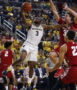 Michigan guard Zavier Simpson (3) makes a layup during the second half of an NCAA college basketball game against Wisconsin, Saturday, Feb. 9, 2019, in Ann Arbor, Mich. (AP Photo/Carlos Osorio)