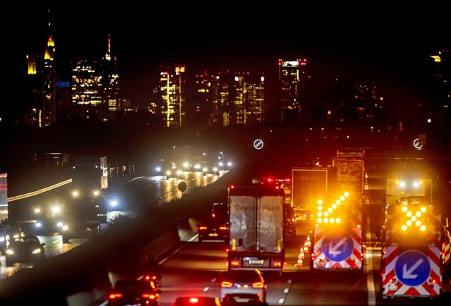 Cars and trucks drive on the main highway with the buildings of the banking district in background in Frankfurt, Germany, Monday, Sept. 14, 2020. (AP Photo/Michael Probst)