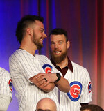 Chicago Cubs' Kris Bryant, left, talks with Ben Zobrist at the Cubs' annual baseball convention Friday, Jan. 12, 2018, in Chicago. (AP Photo/Charles Rex Arbogast)