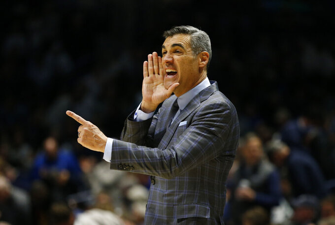 Villanova head coach Jay Wright gives instructions to his team against Xavier during the first half of an NCAA college basketball game, Saturday, Feb. 22, 2020, in Cincinnati. (AP Photo/Gary Landers)