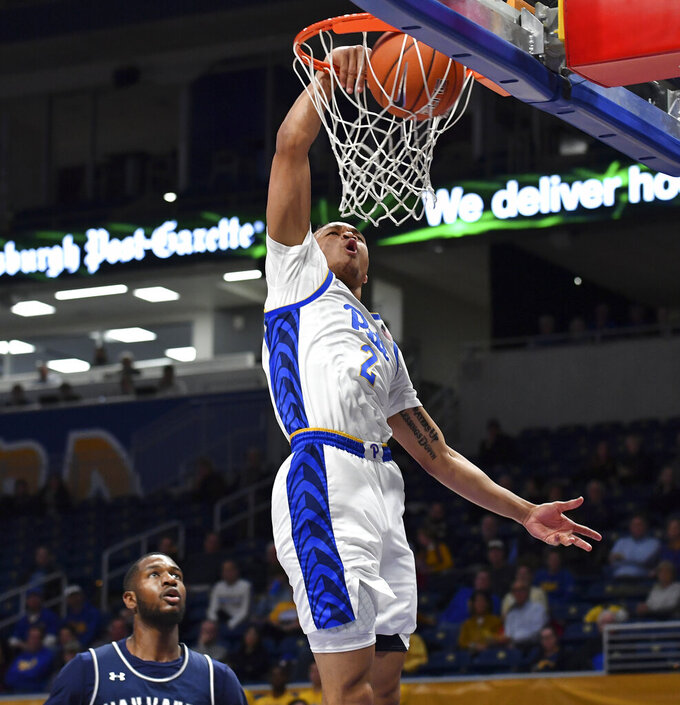 Pitt guard Trey McGowens dunks against Monmouth in the first half of an NCAA college basketball game Monday, Nov. 18, 2019, in Pittsburgh, Pa. (Matt Freed/Pittsburgh Post-Gazette via AP)