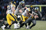 Purdue quarterback David Blough, right, gets tackled by Iowa defensive back Geno Stone (9) in the second half of an NCAA college football game in West Lafayette, Ind., Saturday, Nov. 3, 2018. (AP Photo/AJ Mast)
