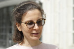 FILE - In this April 8, 2019, file photo, Seagram's liquor fortune heiress Clare Bronfman leaves Brooklyn Federal Court, in New York. Bronfman, the wealthy benefactor of Keith Raniere, the disgraced leader of a self-improvement group in upstate New York convicted of turning women into sex slaves branded with his initials, will be in court, on Wednesday, Sept. 30, 2020, for sentencing on federal conspiracy charges. (AP Photo/Mark Lennihan, File)
