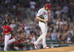 Philadelphia Phillies starting pitcher Aaron Nola walks back to the mound with a fresh baseball after a two-run home run by Boston Red Sox's Jackie Bradley Jr. during the third inning of a baseball game at Fenway Park in Boston, Tuesday, Aug. 20, 2019. (AP Photo/Charles Krupa)
