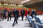 Russian Foreign Minister Sergey Lavrov, center left, walks through Security Council chambers on his way to meet with U.S. Secretary of State Mike Pompeo during the 74th session of the United Nations General Assembly, at U.N. headquarters, Friday, Sept. 27, 2019. (AP Photo/Craig Ruttle)