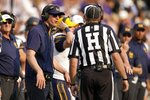 California head coach Justin Wilcox, left, speaks to an official during the second half of an NCAA college football game against TCU in Fort Worth, Texas, Saturday, Sept. 11, 2021. (AP Photo/Tony Gutierrez)