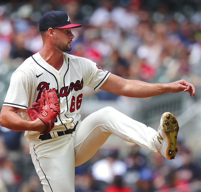 Atlanta Braves starting pitcher Kyle Muller delivers a pitch against the San Diego Padres during the first inning in the first game of a baseball doubleheader Wednesday, July 21, 2021, in Atlanta. (Curtis Compton/Atlanta Journal-Constitution via AP)