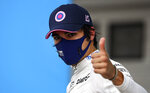 Racing Point driver Lance Stroll of Canada reacts after the qualifying for the Hungarian Formula One Grand Prix at the Hungaroring racetrack in Mogyorod, Hungary, Saturday, July 18, 2020. The Hungarian F1 Grand Prix will be held on Sunday. (Mark Thompson/Pool via AP)