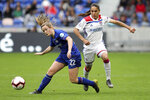 Lyon's Dzsenifer Marozsan, right, challenges for the ball with Chelsea's Erin Cuthberg, left, during their Women's Champions League semifinal soccer match in Decines, France, Sunday, April 21, 2019. (AP Photo/Laurent Cipriani)