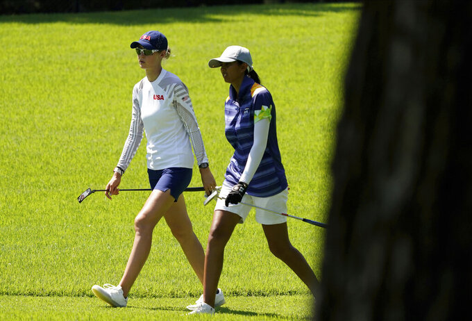 Nelly Korda, of the United States, left, and Aditi Ashok, of India, speak on the fourth fairway during the third round of the women's golf event at the 2020 Summer Olympics, Friday, Aug. 6, 2021, at the Kasumigaseki Country Club in Kawagoe, Japan. (AP Photo/Matt York)
