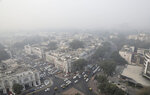 Delhi's sky line is seen enveloped in smog and dust in New Delhi, India, Friday, Nov. 1, 2019. An expert panel in India's capital has declared a health emergency due to air pollution choking the city, with authorities ordering schools closed until Nov. 5. (AP Photo/Manish Swarup)