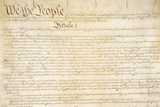 This photo made available by the U.S. National Archives shows a portion of the first page of the United States Constitution. Sotheby's announced Friday that in November it will put up for auction one of just 11 surviving copies of the Constitution from the official first printing produced for the delegates to the Constitutional Convention and for the Continental Congress. It's the only copy that remains in private hands and has an estimate of $15 million-$20 million. (National Archives via AP)