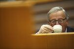 European Commission President Jean-Claude Juncker takes a drink at the European Parliament in Brussels, Thursday, Jan. 31, 2019. European Union leaders offered a united chorus of