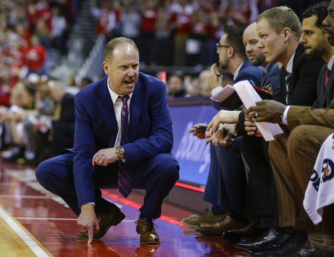 Wisconsin coach Greg Gard talks to players and coaches on the bench during the second half of the team's NCAA college basketball game against Iowa on Thursday, March 7, 2019, in Madison, Wis. Wisconsin won 65-45. (AP Photo/Andy Manis)