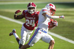 SMU wide receiver Tyler Page (4) is tackled by Temple cornerback Kimere Brown (24) during the first half of an NCAA college football game, Saturday, Nov. 7, 2020, in Philadelphia. (AP Photo/Laurence Kesterson)