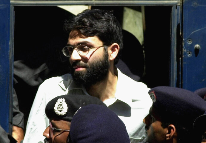FILE - In this March 29, 2002, file photo, Ahmed Omar Saeed Sheikh, the alleged mastermind behind the Wall Street Journal reporter Daniel Pearl's kidnap-slaying, appears at the court in Karachi, Pakistan. Pakistan's Supreme Court is to hear an appeal Monday, Sept. 28, 2020, by the family of slain American journalist Daniel Pearl that challenges the acquittal of a British-born Pakistani in the gruesome 2002 beheading of the Wall Street Journal reporter. (AP Photo/Zia Mazhar, File)