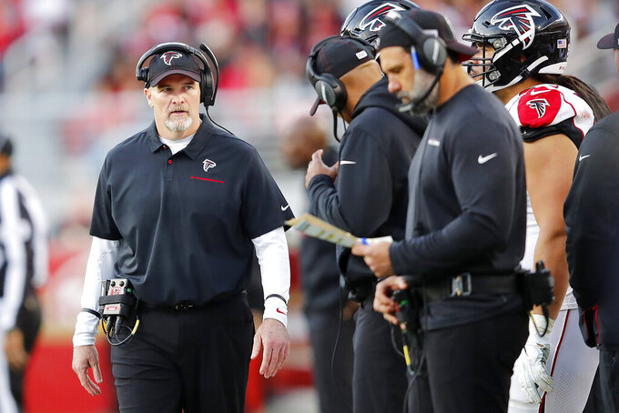 Atlanta Falcons head coach Dan Quinn walks on the sideline during the second half of an NFL football game against the San Francisco 49ers in Santa Clara, Calif., Sunday, Dec. 15, 2019. (AP Photo/John Hefti)