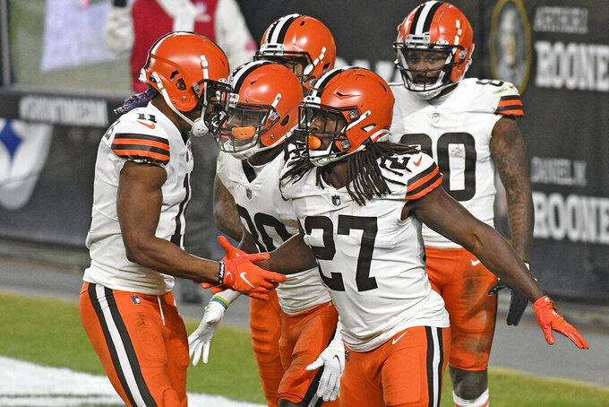 Cleveland Browns running back Kareem Hunt (27) celebrates after scoring on an 11-yard run during the first half of an NFL wild-card playoff football game against the Pittsburgh Steelers in Pittsburgh, Sunday, Jan. 10, 2021. (AP Photo/Don Wright)