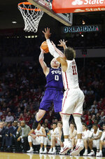 TCU's Jaylen Fisher (0) shoots the ball over Oklahoma's Trae Young (11) during the first half of an NCAA college basketball game in Norman, Okla., Saturday, Jan. 13, 2018. (AP Photo/Garett Fisbeck)