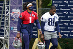 New England Patriots quarterback Cam Newton (1) and tight end Jonnu Smith (81) step on the field at the start of an NFL football practice, Wednesday, July 28, 2021, in Foxborough, Mass. (AP Photo/Steven Senne)