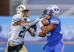 FILE - In this Dec. 21, 2018, file photo, Western Michigan defensive back Stefan Claiborne (21) tries to knock the ball from the grasp of BYU wide receiver Aleva Hifo (15) on a 70-yard touchdown reception in the second half of the Famous Idaho Potato Bowl NCAA college football game, in Boise, Idaho. Utah is seeking a ninth consecutive victory over in-state rival BYU. The Cougars are looking to spring an upset on the defending Pac-12 South champs to kick off a tough four-game stretch. (AP Photo/Steve Conner, File)