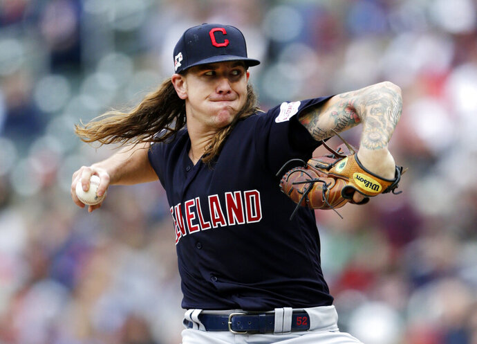 Cleveland Indians pitcher Mike Clevinger throws to the Minnesota Twins in the first inning during a baseball game Sunday, Sept. 8, 2019, in Minneapolis. (AP Photo/Andy Clayton-King)