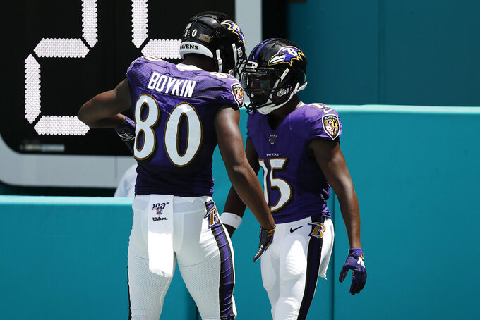 Baltimore Ravens wide receiver Miles Boykin (80) congratulates wide receiver Marquise Brown (15), after Brown scored a touchdown, during the first half at an NFL football game, Sunday, Sept. 8, 2019, in Miami Gardens, Fla. (AP Photo/Brynn Anderson)