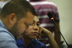 FILE - In this Oct. 11, 2019 file photo, lawyer Eduardo Rubi, left, appears in court with his client Nicaraguan Orlando Tercero in Managua, Nicaragua. Moreno is accused of killing of 22-year-old U.S. nursing student Haley Anderson in 2018.  The court proceeding is taking place in Managua, Nicaragua, with a Nicaraguan prosecutor and a Nicaraguan judge applying that country's law. Witnesses have been testifying from Binghamton via streaming video. (AP Photo/Oscar Duarte, File)