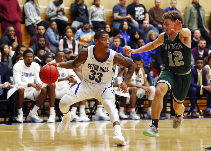 Seton Hall guard Shavar Reynolds (33) drives to the basket against Wagner guard Chase Freeman (12) during the second half of an NCAA college basketball game Tuesday, Nov. 5, 2019, in South Orange, N.J. (AP Photo/Noah K. Murray)