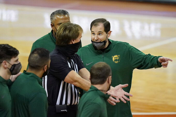 Baylor coach Scott Drew, right, argues a call during the second half of the team's NCAA college basketball game against Texas, Tuesday, Feb. 2, 2021, in Austin, Texas. (AP Photo/Eric Gay)