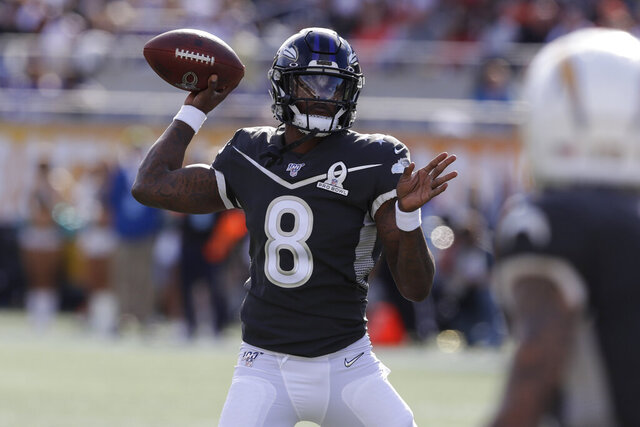 AFC quarterback Lamar Jackson, of the Baltimore Ravens, (8) looks to pass, during the first half of the NFL Pro Bowl football game against the NFC, Sunday, Jan. 26, 2020, in Orlando, Fla. (AP Photo/Chris O'Meara)