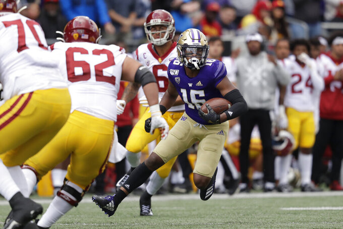 Washington's Cameron Williams (16) returns the ball against Southern Cal after intercepting a pass in the first half of an NCAA college football game Saturday, Sept. 28, 2019, in Seattle. (AP Photo/Elaine Thompson)
