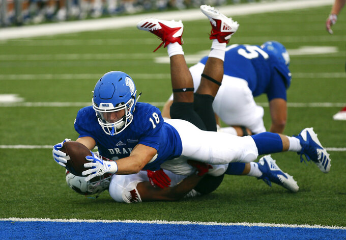 In this Sept. 1, 2018 photo provided by Drake Athletics, Drake running back Braeden Hartwig dives over the goal line during a college football game against William Jewell in Des Moines, Iowa. The Bulldogs were leading 7-0 with 7:18 remaining in the first quarter when lightning halted the game. Drake thought its season was over. But Iowa State needed one more opponent, offering the Bulldogs the opportunity of a lifetime. (Chris Donahue/Drake Athletics via AP)