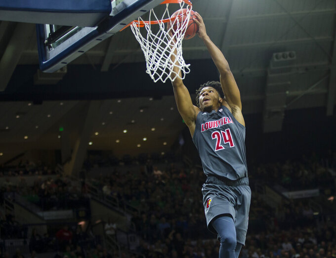 Louisville's Dwayne Sutton (24) dunks against Notre Dame during an NCAA college basketball game, Saturday, Jan. 11, 2020, at Purcell Pavilion in South Bend, Ind. (Michael Caterina/South Bend Tribune via AP)