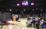 Director of Virginia Tech athletics Whit Babcock, introduces Mike Young as the next men's basketball coach, April 8, 2019. (Michael Shroyer/The Roanoke Times via AP)