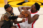 Los Angeles Lakers guard Kentavious Caldwell-Pope, left, blocks the shot of Houston Rockets forward Jae'Sean Tate during the second half of an NBA basketball game Wednesday, May 12, 2021, in Los Angeles. (AP Photo/Mark J. Terrill)