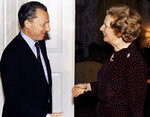 FILE - In this Oct. 15, 1984 file photo, Britain's Prime Minister Margaret Thatcher greets France's Jacques Delors, the then president-elect of the European Commission, inside 10 Downing Street, London. Thatcher's 11-year premiership became increasingly dominated by her opposition to what later became known as the European Union, in particular Delors' plan to create a European single currency. On Jan. 31, 2020, Britain is scheduled to leave the EU after 47 years. (Pool Photo via AP, File)