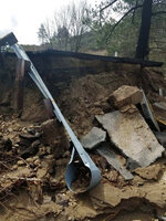 This Friday, Feb. 15, 2019, photo released by Caltrans District 8 shows storm damage to the San Jacinto Mountains Highway 243 near Idyllwild, Calif. Rainwater continues to drain Friday from California's saturated landscapes, and road crews in parts of Colorado, Montana and Wyoming are working to clear avalanches. The damage included a collapse of about 75 feet (23 meters) of pavement in the San Jacinto Mountains. (Caltrans District 8 via AP)