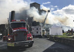 Firefighters battle a fire at the Pocono Manor Resort, Friday, Nov. 1, 2019 in Pocono Manor, Pa. A wind-whipped fire has destroyed much of a century-old Poconos resort that's on the National Register of Historic Places. (Andrew Scott/The Morning Call via AP)