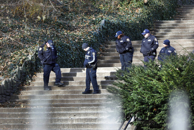 In this Dec. 2, 2019, file photo, law enforcement officers search Morningside Park along Manhattan's Upper West Side neighborhood in New York after an 18-year-old Barnard College freshman, identified as Tessa Majors, was fatally stabbed during an armed robbery in the park. One of the three teenagers charged in the stabbing death of the college student in New York pleaded guilty Wednesday, June 3, 2020, to robbery. The teen had been arrested just days after the Dec. 11 killing of Majors in and initially faced a murder charge before pleading to robbery. (AP Photo/Richard Drew, File)