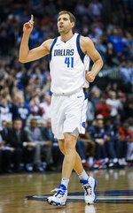 Dallas Mavericks forward Dirk Nowitzki (41) celebrates after passing Wilt Chamberlain for the NBA's sixth-leading scoring record during the first half of an NBA basketball game against the New Orleans Pelicans in Dallas on Monday, March 18, 2019. (Ashley Landis/The Dallas Morning News via AP)