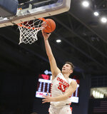 Dayton's Ryan Mikesell (33) scores during the first half of an NCAA college basketball game against St. Louis, Saturday, Feb. 8, 2020, in Dayton, Ohio. (AP Photo/Tony Tribble)