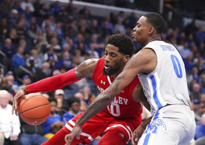 Memphis forward D.J Jeffries (0) guards Bradley forward Elijah Childs (10) in the first half of an NCAA college basketball game Tuesday, Dec. 3, 2019, in Memphis, Tenn. (AP Photo/Karen Pulfer Focht)