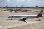FILE - In this June 16, 2018 file photo, American Airlines aircrafts are seen at Dallas-Fort Worth International Airport in Grapevine, Texas. American Airlines reports earnings Thursday, Oct. 25. (AP Photo/Kiichiro Sato, File)